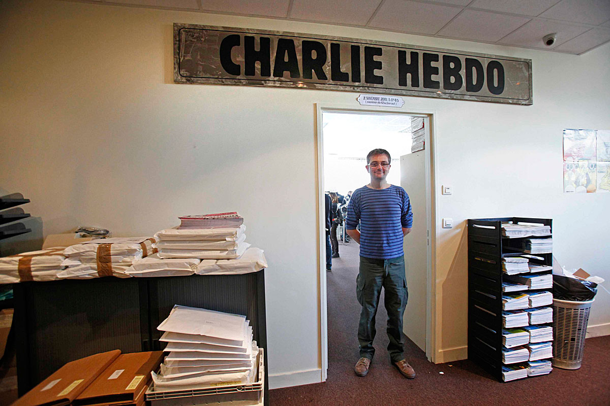 French cartoonist Charb, publishing director of French satirical weekly Charlie Hebdo, poses for photographs at their offices in Paris, September 19, 2012. Charlie Hebdo published cartoons of the Prophet Mohammad on Wednesday, a decision criticised b
