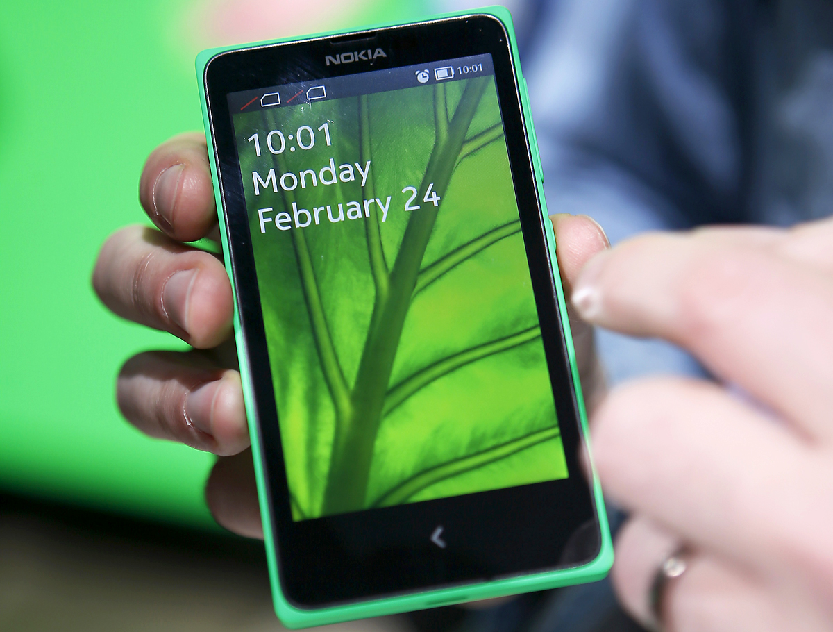 The Nokia X is seen at its unveiling at the Mobile World Congress in Barcelona, February 24, 2014. Nokia, soon to be acquired by Microsoft Corp, is turning to software created by arch-rival Google for a new line of phones it hopes will make it a late