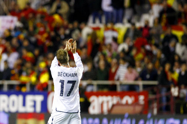 England's David Beckham applauds after their friendly international soccer match against Spain at the Ramon Sanchez Pizjuan stadium in Seville February 11, 2009.