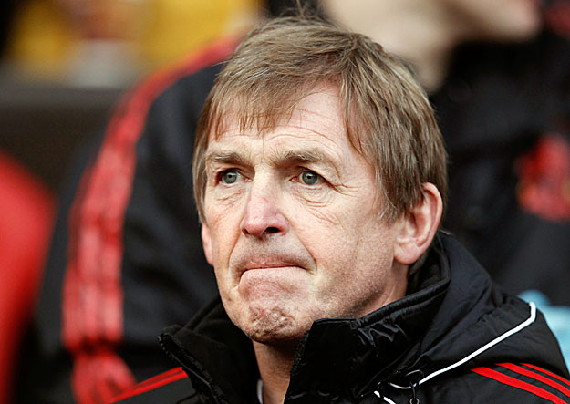 Liverpool's manager Kenny Dalglish walks onto the pitch before the start of the FA Cup soccer match against Manchester United at Old Trafford in Manchester, northern England January 9, 2011. REUTERS/Phil Noble (BRITAIN - Tags: SPORT SOCCER)